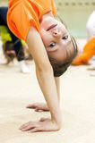 The girl athlete is on his hands Royalty Free Stock Photography
