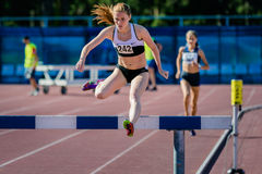 Girl athlete overcomes obstacles. Chelyabinsk, Russia - July 24, 2015: girl athlete overcomes obstacles during National competitions in memory of G. I. Nicewhen Royalty Free Stock Photo