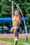 Girl athlete pole vault Royalty Free Stock Photography