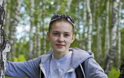 The girl athlete posing in a birch forest Stock Photo