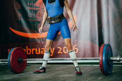 Girl athlete of powerlifting competition. Preparing for attempt in deadlift Stock Photos