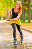 Girl athlete on roller skates Royalty Free Stock Photo