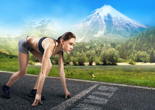 Girl athlete running on the road Royalty Free Stock Photography