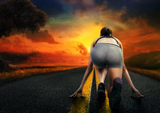 Girl athlete running on the road Stock Photos