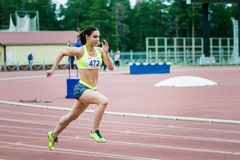 Girl athlete running a sprint. Chelyabinsk, Russia - July 05, 2015: girl athlete running a sprint during Championship of Russia on track and field athletics royalty free stock photos