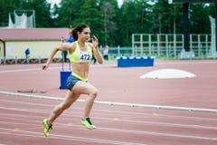 Girl athlete running a sprint Royalty Free Stock Photos