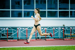 Girl athlete running a sprint. Chelyabinsk, Russia - July 05, 2015: girl athlete running a sprint during Championship of Russia on track and field athletics stock photography
