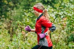 Girl athlete runs through the forest Royalty Free Stock Photo