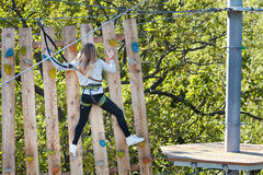 Girl athlete runs an obstacle course Royalty Free Stock Photography