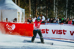 Girl athlete snowboarder joy of winners after finish Royalty Free Stock Photo