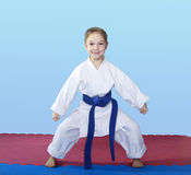 Girl athlete stands in rack of karate Stock Photos