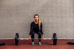 Girl athlete in starting position deadlift Royalty Free Stock Image