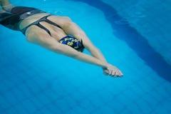 Girl athlete in swimming start swimming under water Stock Photo