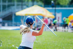 Girl athlete throwing javelin Stock Photos