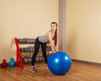 Girl athlete trains back on fit ball. Royalty Free Stock Photography