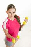 Girl athlete with two dumbbells Stock Photos