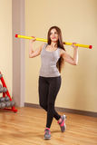 Girl athlete warming up with fit bar. Royalty Free Stock Photos