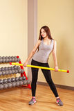 Girl athlete warming up with fitbar. Stock Photography