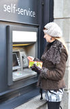 Girl at ATM Royalty Free Stock Images