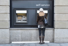 Girl at ATM Royalty Free Stock Photography