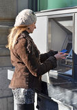 Girl at ATM Royalty Free Stock Photos