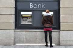 Girl at ATM. Withdrawing money Stock Images