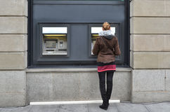 Girl at ATM. Withdrawing money stock photos
