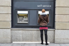 Girl at ATM. Withdrawing money Royalty Free Stock Photos