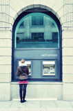 Girl at ATM Royalty Free Stock Photo