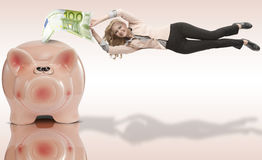 Girl attached to her savings Royalty Free Stock Photo