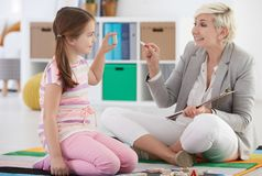 Girl attending session with therapist Royalty Free Stock Photography