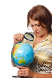 Girl attentively examines the globe Royalty Free Stock Photo