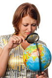 Girl attentively examines the globe Royalty Free Stock Image