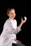 Girl attentively look at a magic sphere Stock Photo