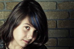 Girl with attitude. A young pre-teen with attitude in front of brick wall royalty free stock photos