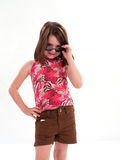 Girl with Attitude. Little girl wearing sunglasses giving big attitude royalty free stock photo