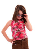 Girl with Attitude. Little girl wearing sunglasses giving big attitude royalty free stock photos