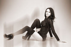 Girl. Attractive girl in black. sepia royalty free stock photography