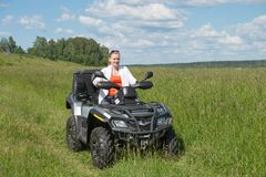 Girl ATV driver Royalty Free Stock Photography