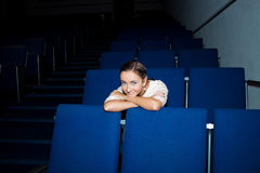 Girl in the auditorium Royalty Free Stock Image