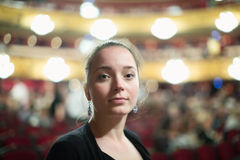 Girl in auditorium of teatre Stock Photography