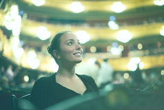 Girl in auditorium of teatre Royalty Free Stock Photography