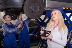 Girl in auto repair shop Royalty Free Stock Images