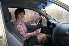 The girl in the automobile Stock Photos