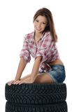 The girl with automobile tyres Stock Photos