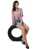 The girl with automobile tyres Stock Images