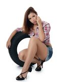 The girl with automobile tyres Royalty Free Stock Image