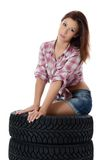 The girl with automobile tyres Stock Photography