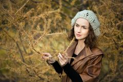 Girl in autumn Stock Images