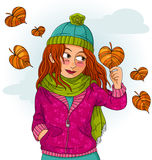 Girl in autumn. Girl holding a heart shaped leaf Royalty Free Stock Photography